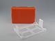 Üres műanyag doboz (narancs), fali tartóval
